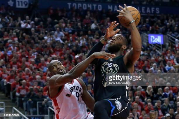 Toronto Raptors forward Serge Ibaka draws a foul on Milwaukee Bucks center Greg Monroe Toronto Raptors vs Milwaukee Bucks in 2nd half action of NBA...