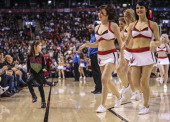TORONTO ON DECEMBER 10 Toronto Raptors future dance pack member does all the moves from the endge of the court as the San Antonio Spurs defeated...