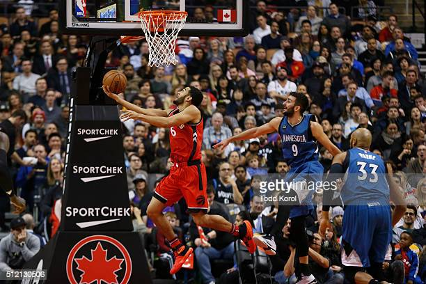 Toronto Raptors guard Cory Joseph gets past Minnesota Timberwolves guard Ricky Rubio and forward Adreian Payne for a basket in the first half of...
