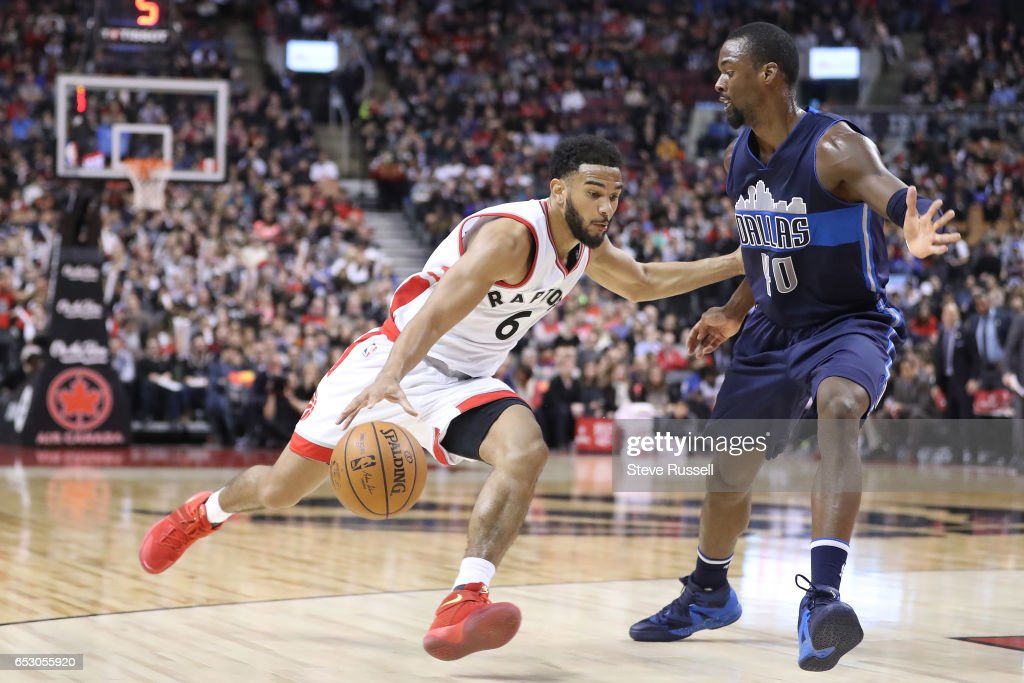 TORONTO, ON- MARCH 13 - Toronto Raptors guard Cory Joseph (6) sprints past Dallas Mavericks forward Harrison Barnes (40) as the Toronto Raptors beat the Dallas Mavericks 100-78 at the Air Canada Centre in Toronto. March 13, 2017.
