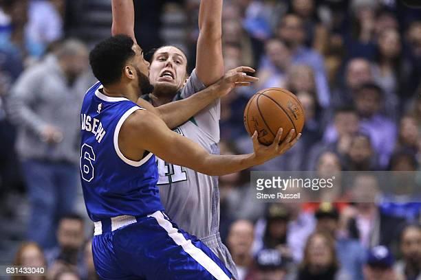 TORONTO ON JANUARY 10 Toronto Raptors guard Cory Joseph tries to get around Boston Celtics center Kelly Olynyk as the Toronto Raptors wearing their...