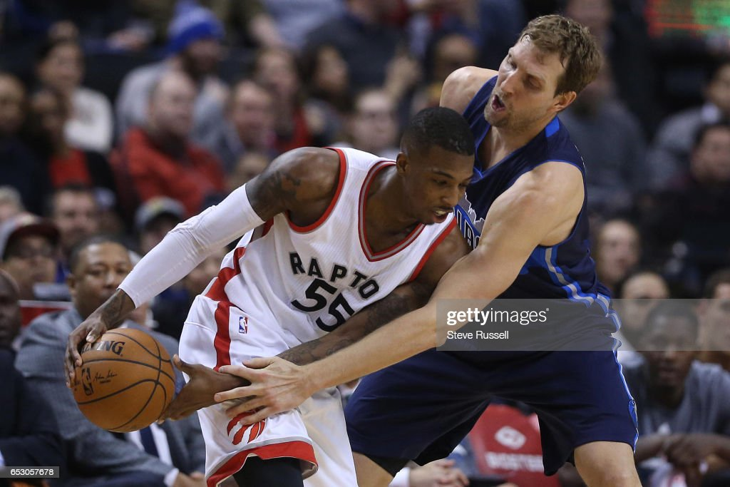 TORONTO, ON- MARCH 13 - Toronto Raptors guard Delon Wright (55) tries to get around Dallas Mavericks forward Dirk Nowitzki (41) as the Toronto Raptors beat the Dallas Mavericks 100-78 at the Air Canada Centre in Toronto. March 13, 2017.