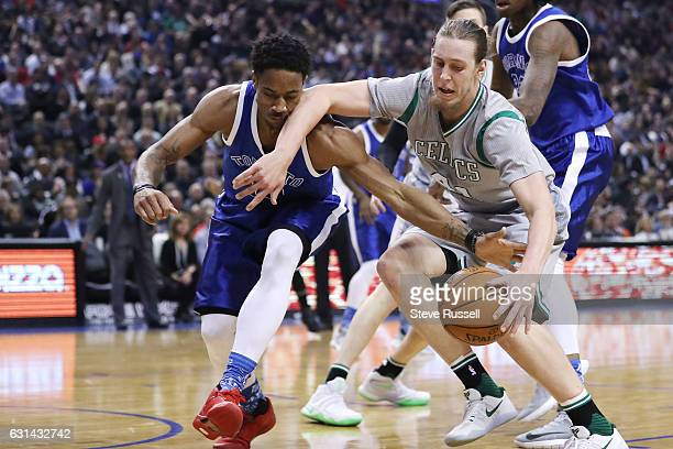 TORONTO ON JANUARY 10 Toronto Raptors guard DeMar DeRozan catches an elbow from Boston Celtics center Kelly Olynyk as the Toronto Raptors wearing...