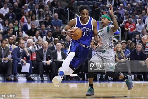 TORONTO ON JANUARY 10 Toronto Raptors guard DeMar DeRozan drives against Boston Celtics guard Isaiah Thomas as the Toronto Raptors wearing their...
