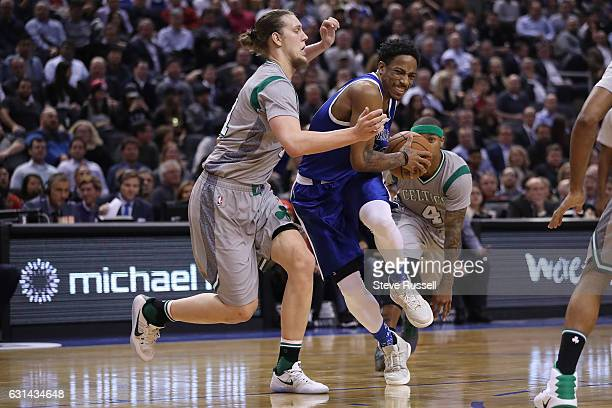 TORONTO ON JANUARY 10 Toronto Raptors guard DeMar DeRozan drives against Boston Celtics center Kelly Olynyk as the Toronto Raptors wearing their...
