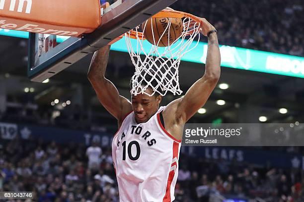 TORONTO ON JANUARY 5 Toronto Raptors guard DeMar DeRozan dunks as the Toronto Raptors beat the Utah Jazz 10193 at Air Canada Centre in Toronto...