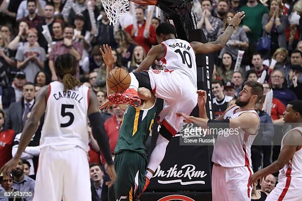 TORONTO ON JANUARY 5 Toronto Raptors guard DeMar DeRozan fouls Gordon Hayward as the Toronto Raptors beat the Utah Jazz 10193 at Air Canada Centre in...