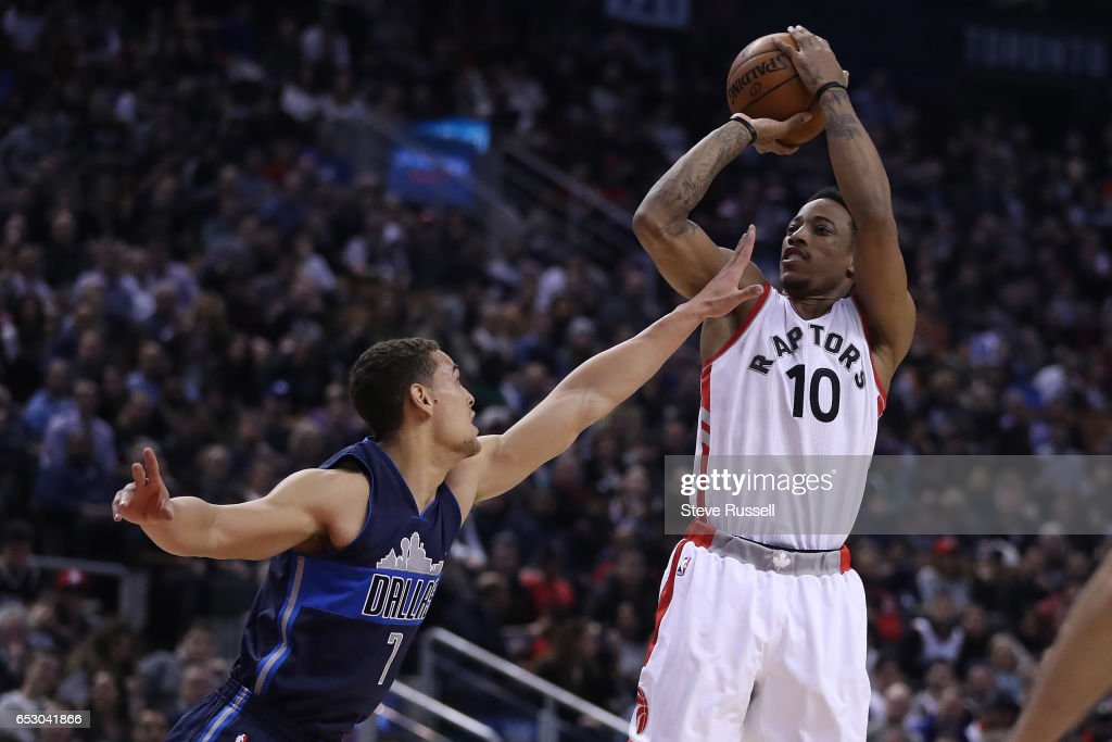 TORONTO, ON- MARCH 13 - Toronto Raptors guard DeMar DeRozan (10) hits two over Dallas Mavericks forward Dwight Powell (7) as the Toronto Raptors play the Dallas Mavericks at the Air Canada Centre in Toronto. March 13, 2017.