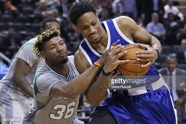 TORONTO ON JANUARY 10 Toronto Raptors guard DeMar DeRozan is fouled by Boston Celtics guard Marcus Smart as the Toronto Raptors wearing their throw...