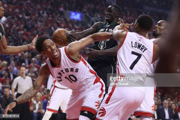 TORONTO APRIL 24 Toronto Raptors guard DeMar DeRozan Kyle Lowry and Serge Ibaka look for the loose ball with Milwaukee Bucks forward Thon Maker as...