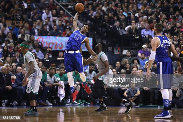 TORONTO ON JANUARY 10 Toronto Raptors guard DeMar DeRozan leaps for a pass in front of Boston Celtics forward Jaylen Brown as the Toronto Raptors...