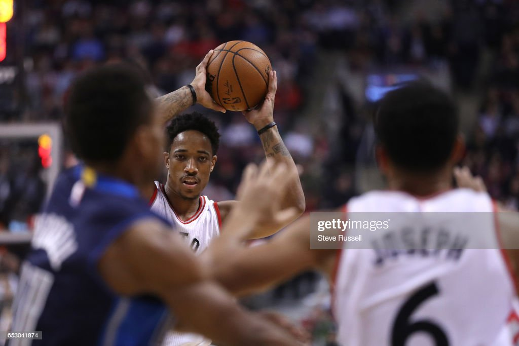 TORONTO, ON- MARCH 13 - Toronto Raptors guard DeMar DeRozan (10) looks to pass to Cory Joseph as the Toronto Raptors play the Dallas Mavericks at the Air Canada Centre in Toronto. March 13, 2017.