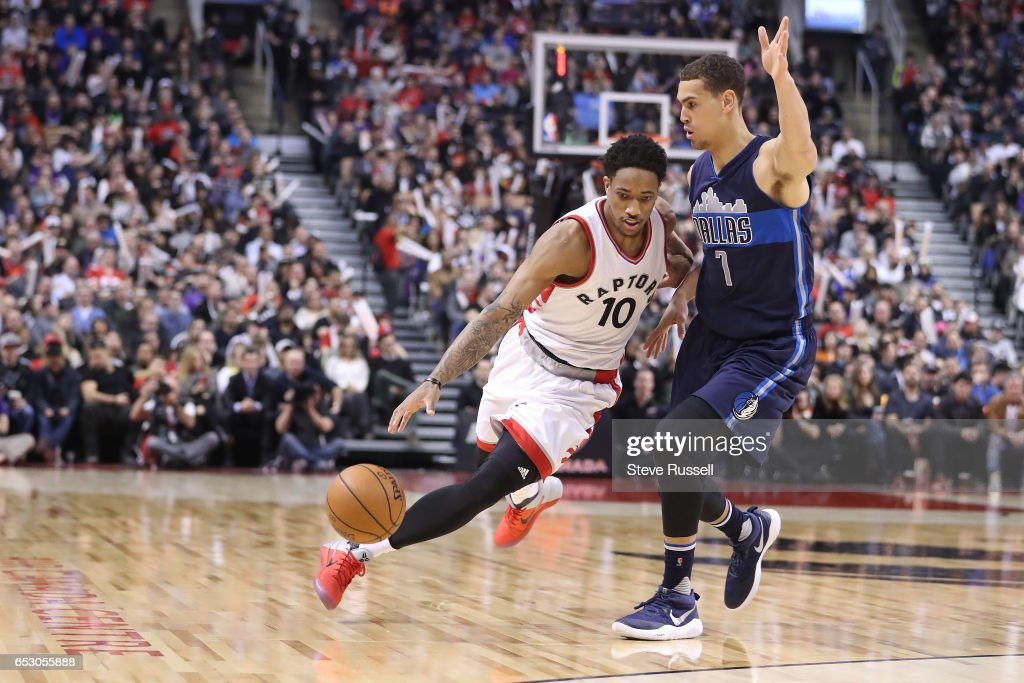 TORONTO, ON- MARCH 13 - Toronto Raptors guard DeMar DeRozan (10) sprints around Dallas Mavericks forward Dwight Powell (7) as the Toronto Raptors beat the Dallas Mavericks 100-78 at the Air Canada Centre in Toronto. March 13, 2017.