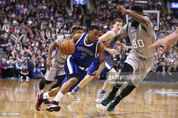 TORONTO ON JANUARY 10 Toronto Raptors guard Kyle Lowry drives past Boston Celtics forward Amir Johnson as the Toronto Raptors wearing their throw...