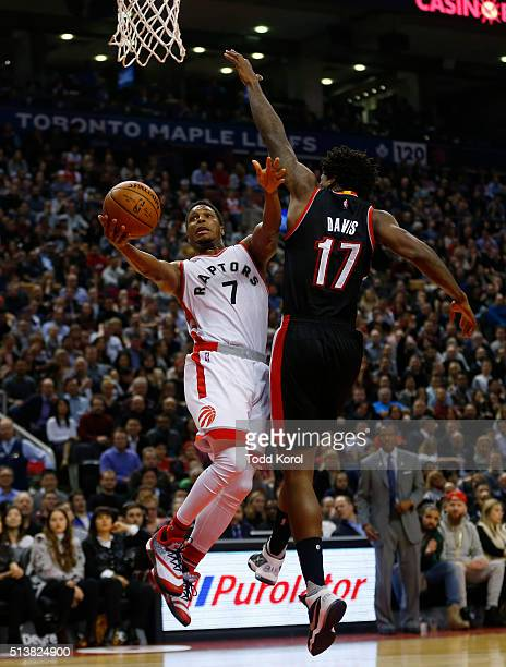 Toronto Raptors guard Kyle Lowry goes to the basket against Portland Trail Blazers centre Ed Davis in the first half of their NBA basketball game at...