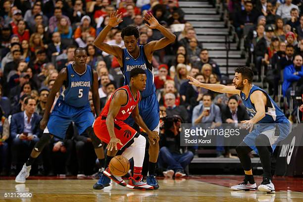 Toronto Raptors guard Kyle Lowry is surrounded by Minnesota Timberwolves center Gorgui Dieng guard Andrew Wiggins and guard Ricky Rubio in the first...