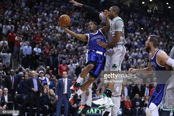 TORONTO ON JANUARY 10 Toronto Raptors guard Kyle Lowry puts up shot against Boston Celtics center Al Horford as the Toronto Raptors wearing their...