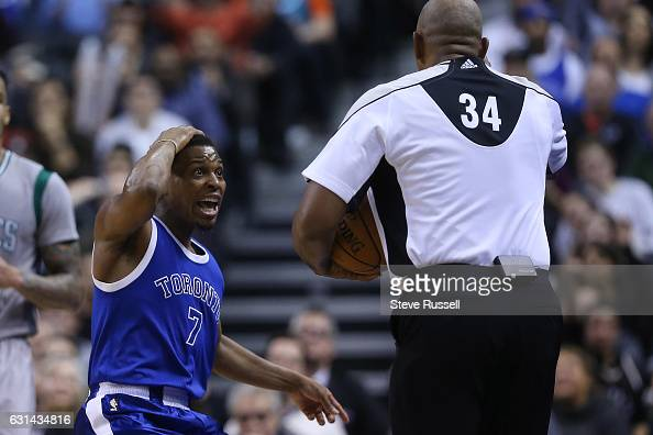 TORONTO ON JANUARY 10 Toronto Raptors guard Kyle Lowry questions referee Kevin Cutler as the Toronto Raptors wearing their throw back Toronto Huskies...