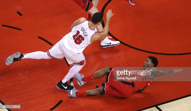 TORONTO ON OCTOBER 19 Toronto Raptors guard Kyle Lowry takes a charge from Chicago Bulls guard Paul Zipser as the Toronto Raptors open their season...
