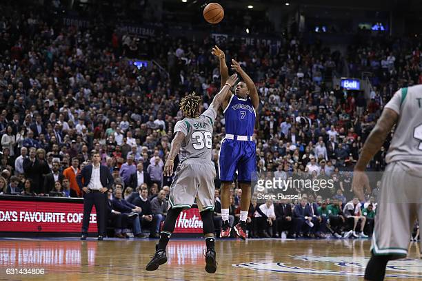 TORONTO ON JANUARY 10 Toronto Raptors guard Kyle Lowry throws up a three pointer against Boston Celtics guard Marcus Smart as the Toronto Raptors...