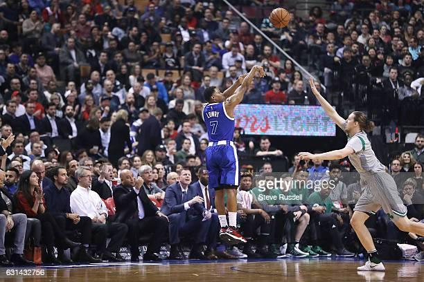 TORONTO ON JANUARY 10 Toronto Raptors guard Kyle Lowry throws up a three pointer as the Toronto Raptors wearing their throw back Toronto Huskies...