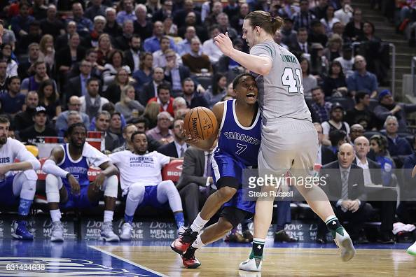 TORONTO ON JANUARY 10 Toronto Raptors guard Kyle Lowry tries to sneak by Boston Celtics center Kelly Olynyk as the Toronto Raptors wearing their...
