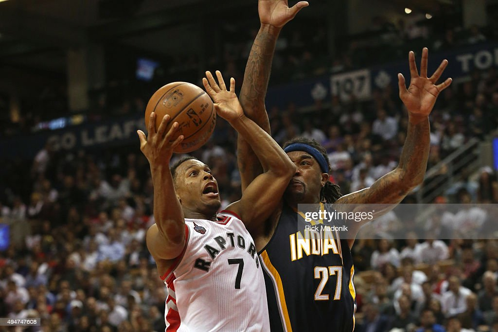 Toronto Raptors guard Kyle Lowry uses a bit of elbow to help keep defender Indiana Pacers center Jordan Hill from the ball as he drives the lane...