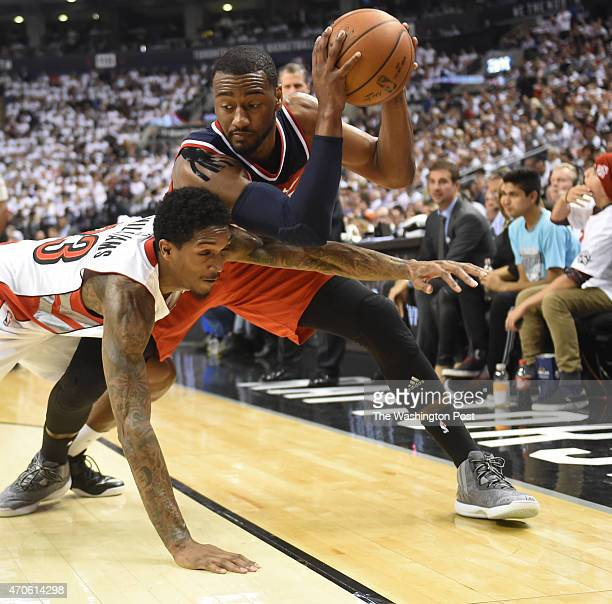 Toronto Raptors guard Louis Williams reaches in on Washington Wizards guard John Wall during game two action on April 21 2015 in Toronto Ontario