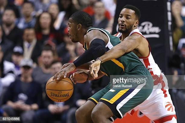TORONTO ON JANUARY 5 Toronto Raptors guard Norman Powell defends against Utah Jazz forward Joe Johnson as the Toronto Raptors beat the Utah Jazz...