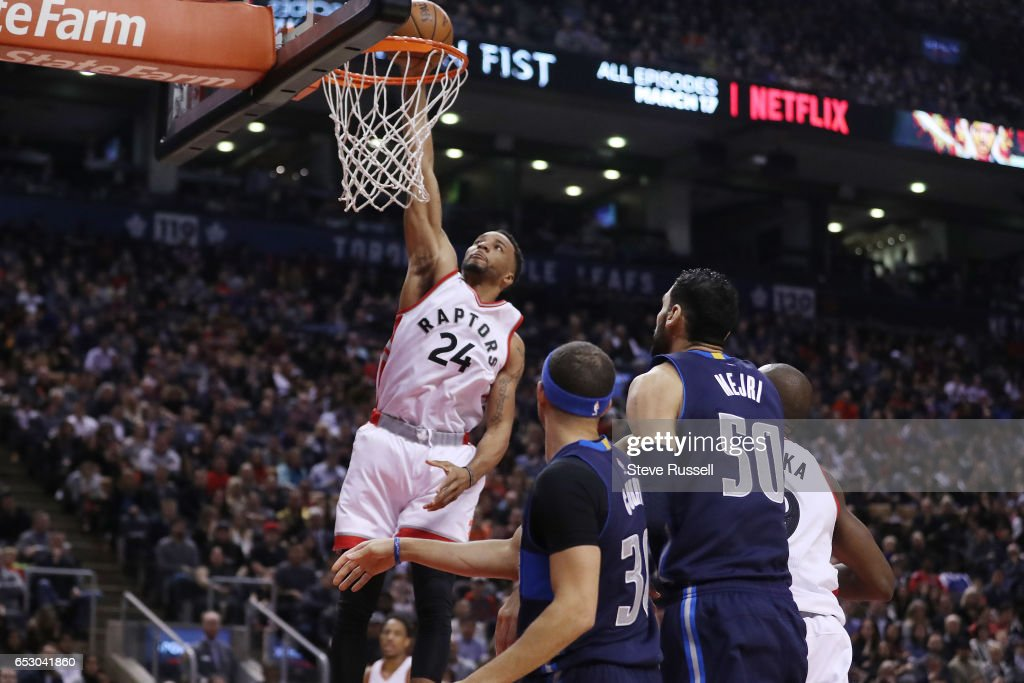 TORONTO, ON- MARCH 13 - Toronto Raptors guard Norman Powell (24) dunks as the Toronto Raptors play the Dallas Mavericks at the Air Canada Centre in Toronto. March 13, 2017.