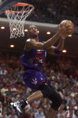 Toronto Raptors guard Tracy McGrady takes to the air for two points during first period of the game with the Orlando Magic at the Arena 23 April 1999...