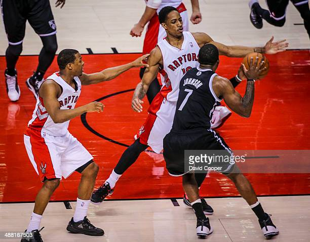 TORONTO ON MAY 4 Toronto Raptors guards Kyle Lowry and DeMar DeRozan double team Brooklyn Nets guard Joe Johnson during the game between the Toronto...