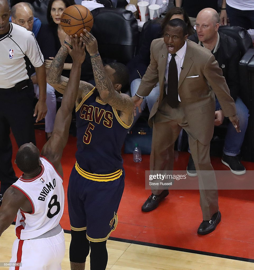 Toronto Raptors head coach Dwane Casey encourages Bismack Biyombo as J.R. Smith shoots as the Toronto Raptors beat the Cleveland Cavaliers in game 4 of the NBA Conference Finals in Toronto. May 23, 2016.