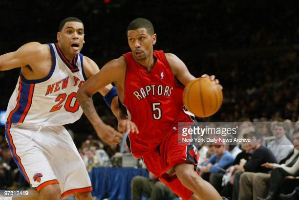 Toronto Raptors' Jalen Rose drives to the basket around New York Knicks' Allan Houston during game at Madison Square Garden The Knicks beat the...