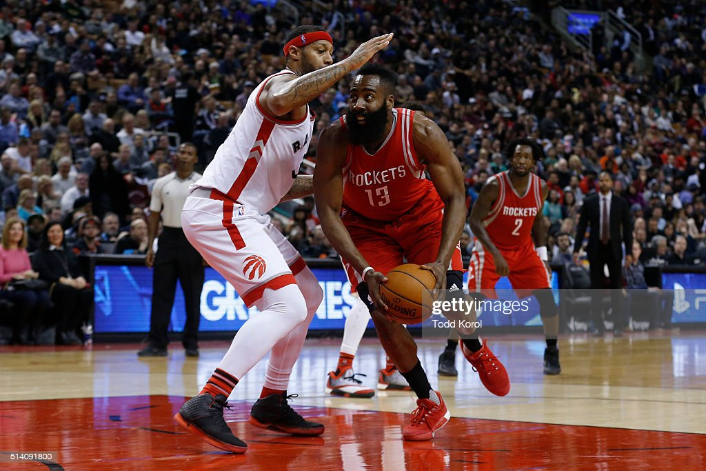 Toronto Raptors James Johnson guards Houston Rockets James Harden in the second half of their NBA basketball game at the Air Canada Centre in Toronto...