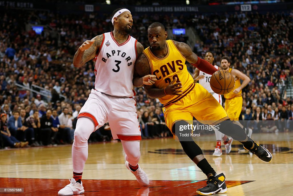 Toronto Raptors James Johnson tries to guard Cleveland Cavaliers LeBron James in the first half of their NBA basketball game at the Air Canada Centre...