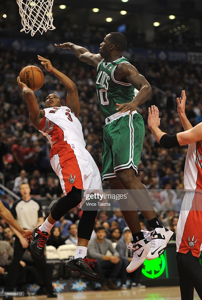 Toronto Raptors Kyle Lowry goes to the net but gets stopped by Boston Celtics Brandon Bass at the Air Canada Centre.
