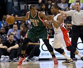 Toronto Raptors Kyle Lowry pushes up against Milwaukee Bucks' Khris Middleton during Monday's game at the Air Canada Centre