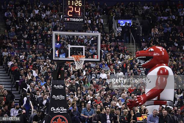 TORONTO ON JANUARY 10 Toronto Raptors mascot The Raptor as the Toronto Raptors wearing their throw back Toronto Huskies uniforms play the Boston...