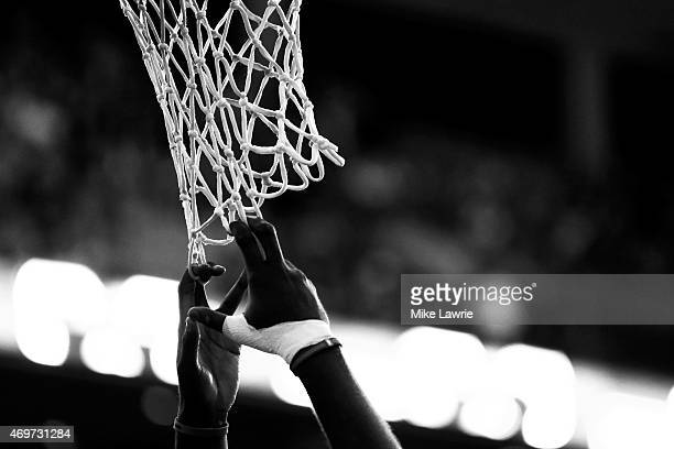 A Toronto Raptors player pulls on the net during introductions before the game against the Boston Celtics at TD Garden on April 14 2015 in Boston...
