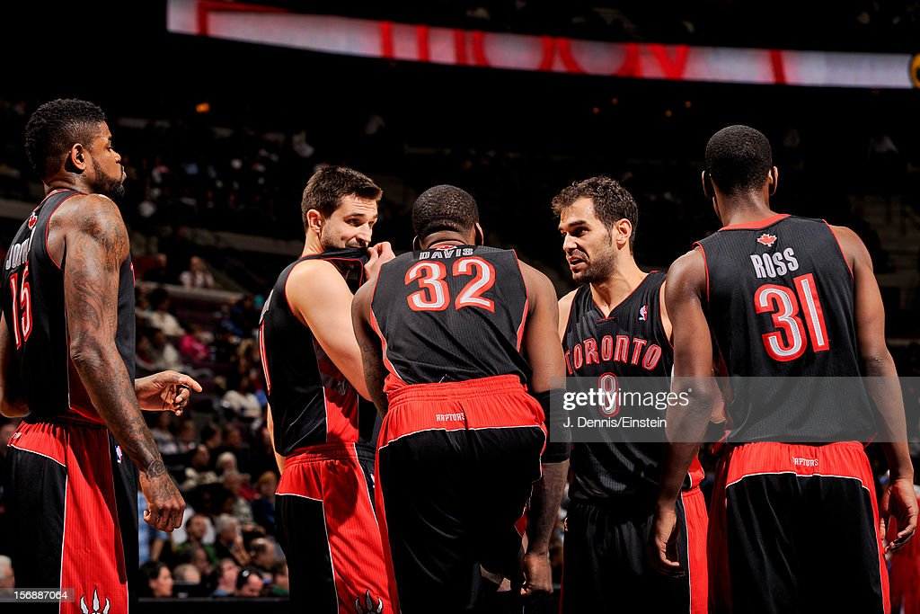 Toronto Raptors players, from left, <a gi-track='captionPersonalityLinkClicked' href=/galleries/search?phrase=Amir+Johnson&family=editorial&specificpeople=556786 ng-click='$event.stopPropagation()'>Amir Johnson</a> #15, <a gi-track='captionPersonalityLinkClicked' href=/galleries/search?phrase=Linas+Kleiza&family=editorial&specificpeople=211014 ng-click='$event.stopPropagation()'>Linas Kleiza</a> #11, Ed Davis #32, <a gi-track='captionPersonalityLinkClicked' href=/galleries/search?phrase=Jose+Calderon&family=editorial&specificpeople=548297 ng-click='$event.stopPropagation()'>Jose Calderon</a> #8 and <a gi-track='captionPersonalityLinkClicked' href=/galleries/search?phrase=Terrence+Ross&family=editorial&specificpeople=6781663 ng-click='$event.stopPropagation()'>Terrence Ross</a> #31 speak before resuming action against the Detroit Pistons on November 23, 2012 at The Palace of Auburn Hills in Auburn Hills, Michigan.