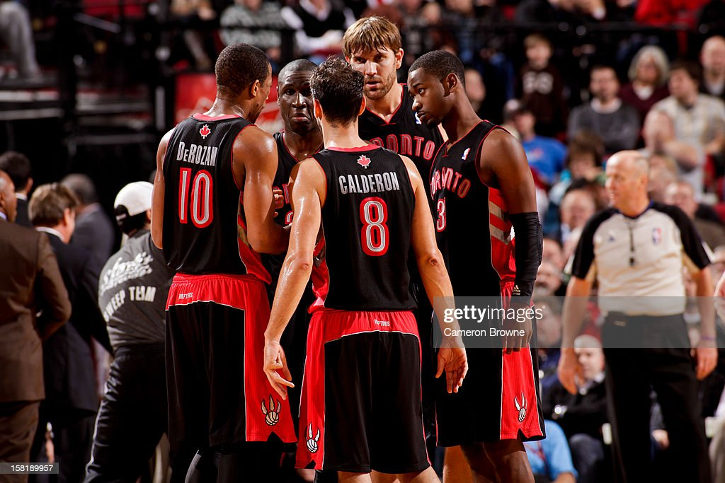 Toronto Raptors players, from left, DeMar DeRozan #10, <a gi-track='captionPersonalityLinkClicked' href=/galleries/search?phrase=Mickael+Pietrus&family=editorial&specificpeople=202910 ng-click='$event.stopPropagation()'>Mickael Pietrus</a> #20, Jose Calderon #8, <a gi-track='captionPersonalityLinkClicked' href=/galleries/search?phrase=Aaron+Gray+-+Basketball+Player&family=editorial&specificpeople=666453 ng-click='$event.stopPropagation()'>Aaron Gray</a> #34 and <a gi-track='captionPersonalityLinkClicked' href=/galleries/search?phrase=Terrence+Ross&family=editorial&specificpeople=6781663 ng-click='$event.stopPropagation()'>Terrence Ross</a> #31 huddle up during a game against the Portland Trail Blazers on December 10, 2012 at the Rose Garden Arena in Portland, Oregon.