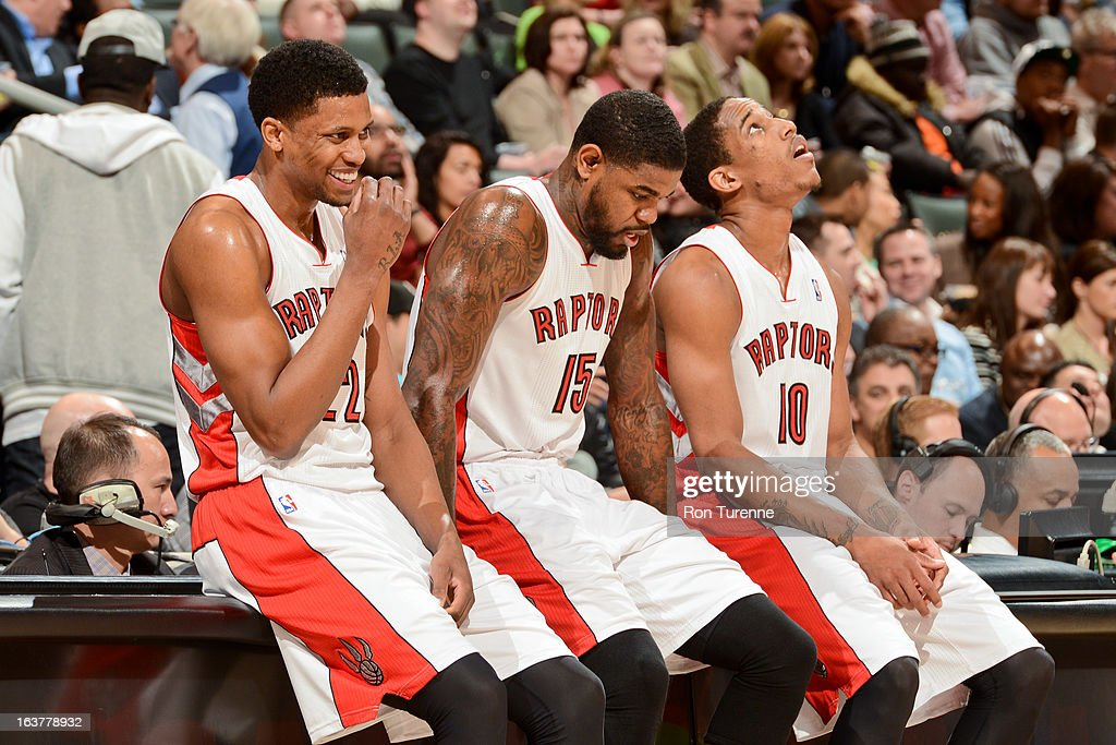 Toronto Raptors players, from left, Rudy Gay #22, Amir Johnson #15 and DeMar DeRozan #10 wait for the start of their game against the Charlotte Bobcats on March 15, 2013 at the Air Canada Centre in Toronto, Ontario, Canada.