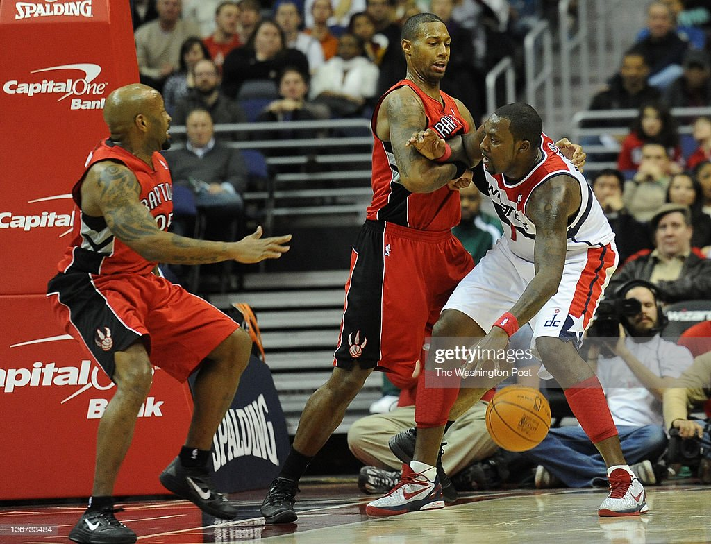 Toronto Raptors point guard Anthony Carter left and Toronto Raptors small forward James Johnson double up on Washington Wizards power forward Andray...
