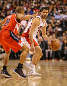 TORONTO ON FEBRUARY 27 Toronto Raptors point guard Greivis Vasquez looks to pass while being guarded by Washington Wizards point guard Andre Miller...