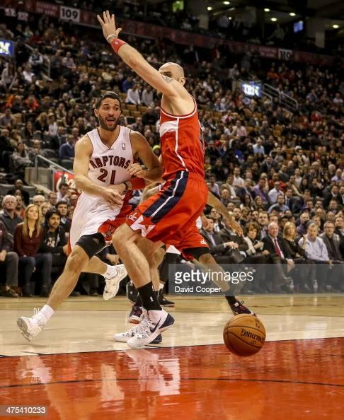 TORONTO ON FEBRUARY 27 Toronto Raptors point guard Greivis Vasquez tires to pass to Toronto Raptors power forward Tyler Hansbrough under the basket...