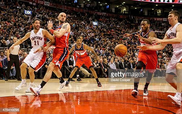 TORONTO ON FEBRUARY 27 Toronto Raptors point guard Greivis Vasquez tries to pass to Toronto Raptors power forward Tyler Hansbrough under the basket...