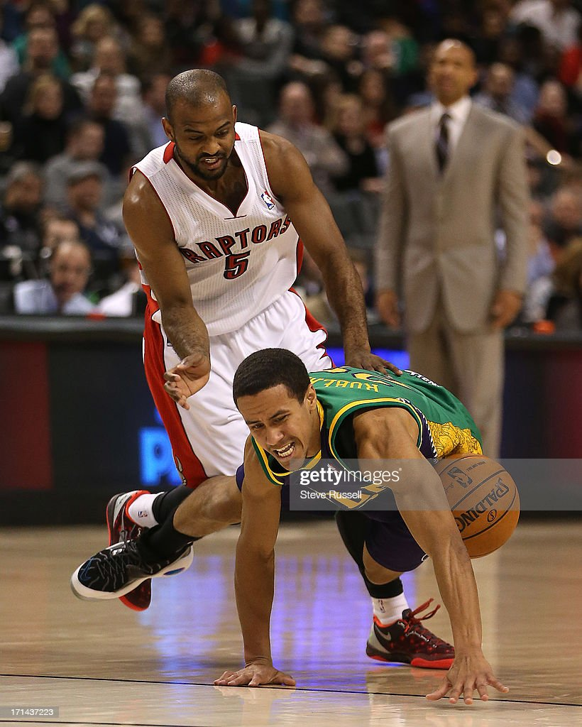 Toronto Raptors point guard John Lucas fouls New Orleans Hornets point guard Brian Roberts as the Toronto Raptors play the New Orleans Hornets at the...