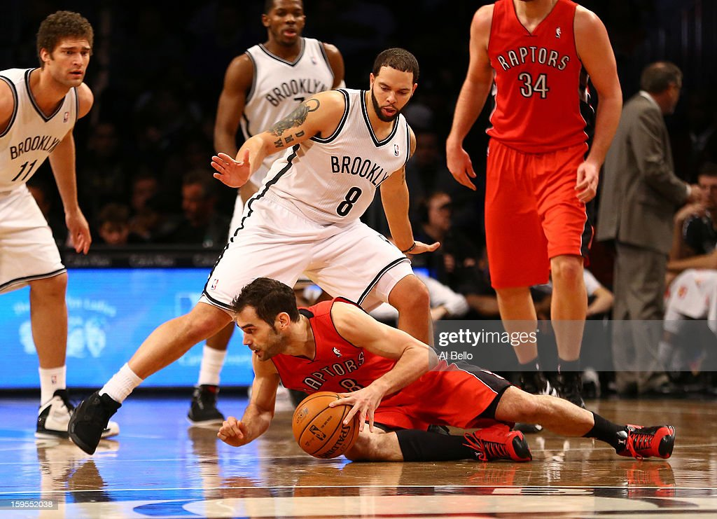 Toronto Raptors point guard Jose Calderon #8 dribbles the ball as Brooklyn Nets point guard <a gi-track='captionPersonalityLinkClicked' href=/galleries/search?phrase=Deron+Williams&family=editorial&specificpeople=203215 ng-click='$event.stopPropagation()'>Deron Williams</a> #8 defends during their game at the Barclays Center on January15, 2013 in the Brooklyn borough of New York City.