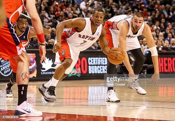 TORONTO ON FEBRUARY 27 Toronto Raptors point guard Kyle Lowry and Raptors center Jonas Valanciunas heads across the top of the key during the game...